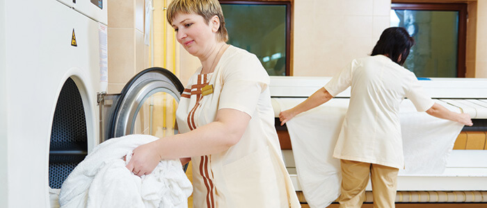 Two housekeepers doing hotel laundry