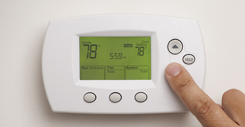 Remote thermostat part with hand toggling the temperature down to 78 degrees
